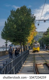 BUDAPEST/HUNGARY - 25 SEPTEMBER 2017: Tram finishing on the Chain Bridge in Budapest. Taken from the Buda side of the Danube on a September afternoon