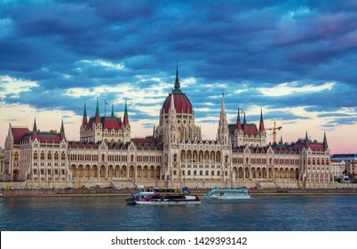 Budapest/Hungary- April 30, 2019:  cityscape with beautiful gothic famous Parliament building, Danube river, touristic cruise boats. Sunset and dark blue clouds on the sky.