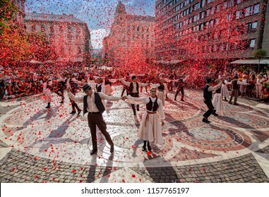 BUDAPEST,HUNGARY - AUGUST 15. 2018 :Folk dance flash mob event in the square in front of St. Stephen Basilica,to the delight of tourists and passers.
