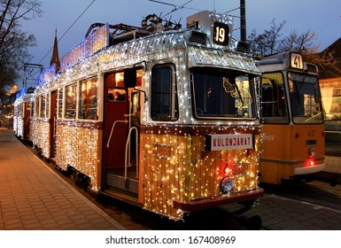 BUDAPEST/HUNGARY - DECEMBER 13: Unidentified people on the special Christmas tram with festive lights in Budapest on December 13, 2013 in Budapest / Hungary