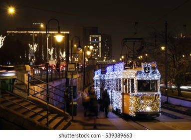 BUDAPEST/HUNGARY - DECEMBER 6: Unidentified people on and next to the special Christmas tram with festive lights in Budapest on December 6, 2016 in Budapest / Hungary