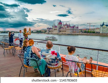 BUDAPEST,HUNGARY - JULY 26, 2018 :Tourist admire from the cruise ship deck the fantastic panoramic view of Budapest with Parliament and the Danube embankment .