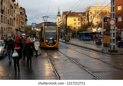 Budapest,Hungary,11.13.2017,A winter morning with sleepy people going to work, and yellow tram number 17.