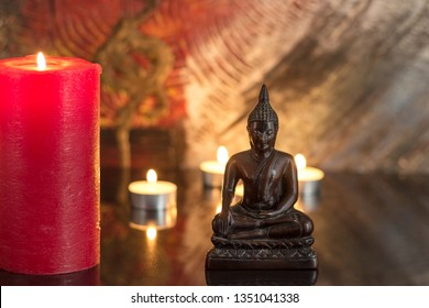 buddah statue with scandles