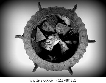 Buddha amulets inside the ancient amulet container on black and white background.