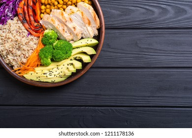 Buddha bowl with avocado , chicken , pepper , quinoa and chickpea . Healthy food