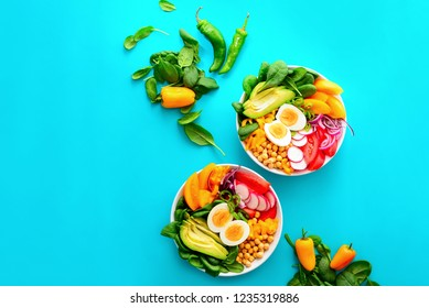 Buddha bowl salad in two bowls, healthy eating concept, view from above, space for a text