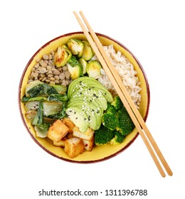 Buddha bowls with vegetables, healthy grains, and protein isolated on white background. Rice, lentils, tofu, avocado, broccoli, brussels sprouts, bok choy, sesame seeds. Vegan food. Top view.