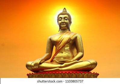 Buddha in Buddhism on sunset background in the evening, beautiful colors.