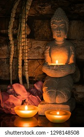 Buddha with candle - Shutterstock ID 1298148508