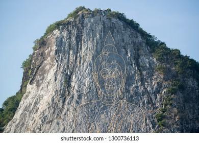 the Buddha Cliff of Khao Chee Chan at the village of Sattahip near the city of Pattaya in the Provinz Chonburi in Thailand.  Thailand, Pattaya, November, 2018
