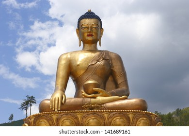 Buddha Dordenma Statue against sky background is a bronze and gold gilded statue overlooking the city of Thimphu, Bhutan. This 169 feet Giant Buddha is one of the tallest Buddhas in the world.