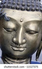 Buddha face, bronze statue