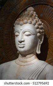 Buddha, face of budda statue in Suan Mokkh Buddhist temple