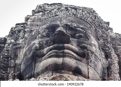 Buddha face by stone in Angkor Thom temple, Cambodia.