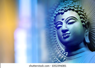 Buddha face On the blue backdrop