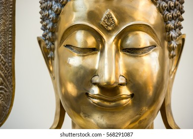 Buddha face peaceful eye and smile
