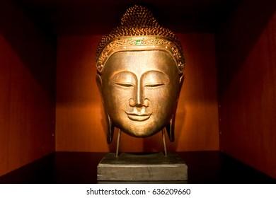 Buddha face sculpture
