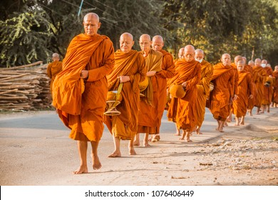 BUDDHA GAYA, INDIA - OCTOBER 21, 2017 : Buddhist Monk Walking for Receive Food at Buddha Gaya, India