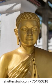 Buddha golden statue, press the hands together at the chest or forehead in sign of respect