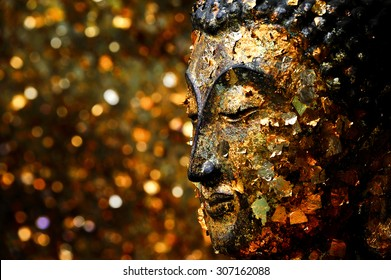 Buddha head filled with gold leaf. Shows the devotion of the Buddhists.