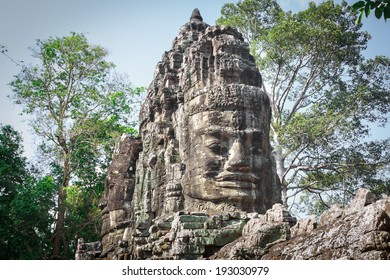 The Buddha heads on the gate of Angkor Thom capital, Angkor Archeological Park, Siem Reap, Cambodia.