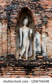 a buddha image attached on the pagoda side
