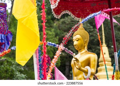 buddha image in parade at the end of buddhist lent day