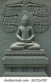 Buddha Image statue made from stone to decorate temple wall in Thailand