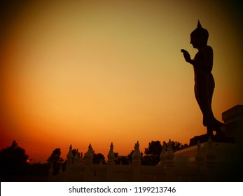 Buddha Image in sundown of evening , Buddhist monasteries of Phitsanulok, Phitsanulok Province, Thailand