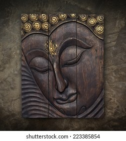 Buddha image in Thai style wood graving on the wall