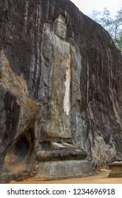 Buddha images carved into the rockface, Buduruwagala sri lanka circa 2013
