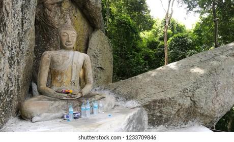 Buddha imprinted on a mountain in Chonburi, Thailand.