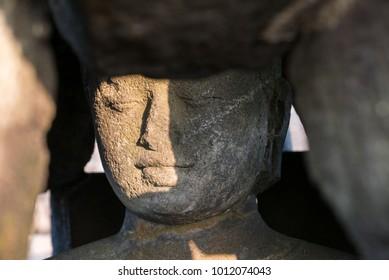 Buddha inside Stupa, Candi Borobudur, Java, Indonesia