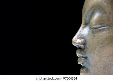 Buddha isolated profile on black background