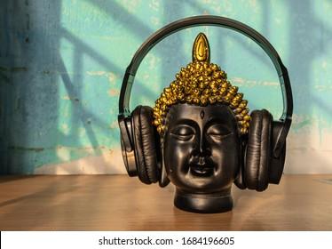 Buddha listening music in headphone unique image