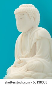 Ivory carving images stock photos vectors shutterstock buddha made from ivory on blue background mozeypictures Images