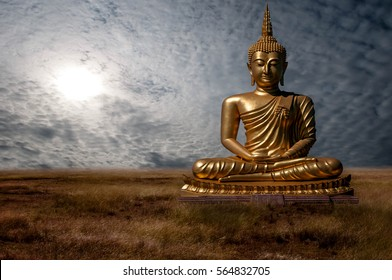 Buddha meditation at sunset on a beautiful blue sky.
