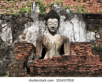 Buddha with old brick wall at Wat Mahathat ,ancient capital city of Sukhothai, has been now Sukhothai Historical Park,UNESCO world Heritage