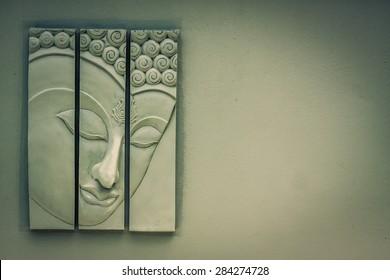 Buddha on an old wall wintage