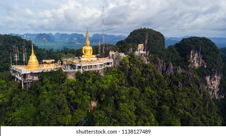 Buddha on the top Mountain of Wat Tham Seua (Tiger Cae) , Krabi,Thailand .