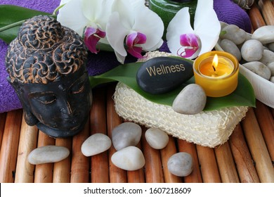 Buddha with orchid candles and stones
