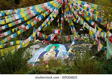 Buddha painting of Tibetan on stone in mountain zone in Sichuan, China