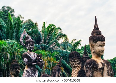 Buddha park in Vientiane, Laos. The landmark of ancient Buddhist stone statues and religious figures