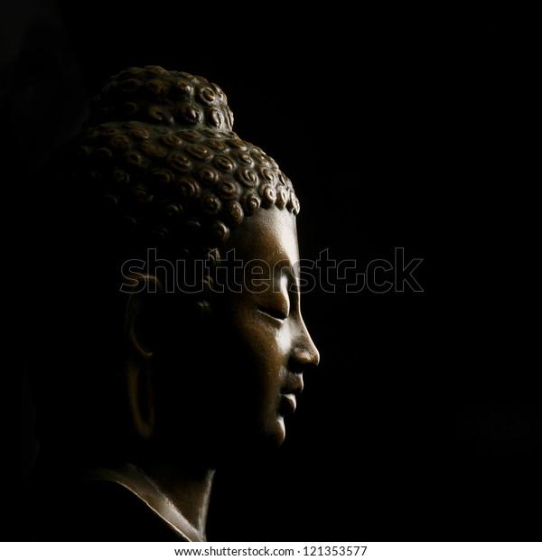 Buddha portrait isolated on black