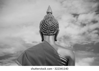 Buddha sculpture in the Asian temple, black and white photo