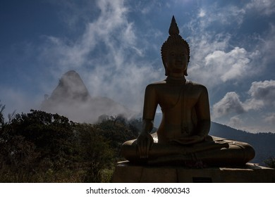 Buddha silhouette with the mist under the moon light