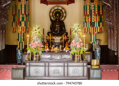Buddha sitting on altar