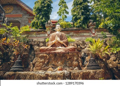 Buddha sitting in the temple Brahmavihara-Arama, Bali, Indonesia