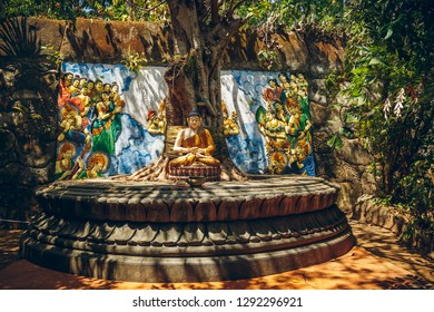 Buddha sitting under tree in the temple Brahmavihara-Arama, Bali, Indonesia